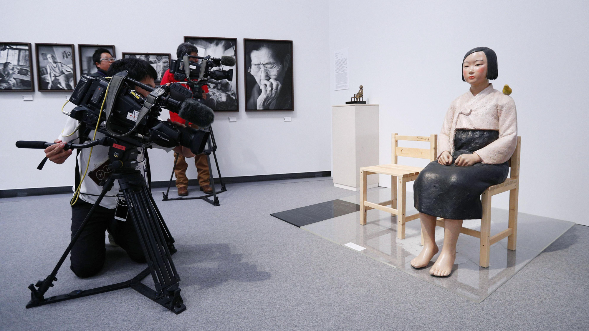 A videographer captures images of a statue symbolizing the 'comfort women' at the Aichi Triennale modern art festival in Nagoya on Aug. 3. | KYODO