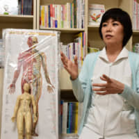 Junko Hirota, 55, an acupuncture and moxibustion therapist, became a registered body donor for anatomical training purposes a few years ago. | KYODO