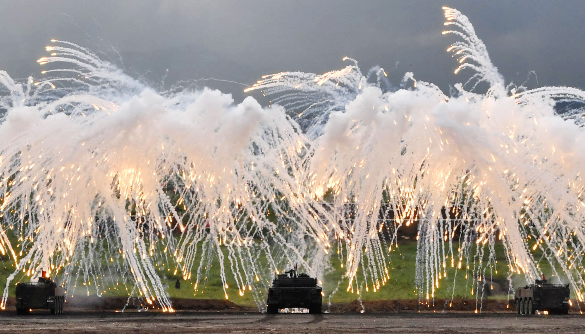 The Ground Self-Defense Force conducts a live-ammunition drill at training grounds at the foot of Mount Fuji in Shizuoka Prefecture on Sunday. | KYODO