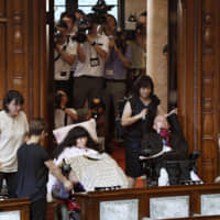 Opposition lawmakers with severe disabilities make Upper House debut after steps taken toward creating barrier-free Diet