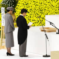 Emperor Naruhito, accompanied by Empress Masako, makes a speech at a service marking the anniversary of Japan's surrender in World War II, at Nippon Budokan Hall in Tokyo on Thursday. | KYODO