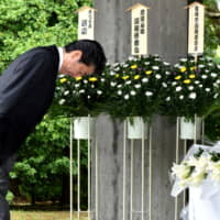 Prime Minister Shinzo Abe prays for the nation's war dead at the Chidorigafuchi National Cemetery in Tokyo on Thursday before attending an annual ceremony marking Japan's surrender in World War II later in the day. | SATOKO KAWASAKI