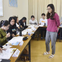 Foreign students take a conversation lesson at a Japanese-language school in Nagoya in April. The percentage of successful visa applications by foreign nationals to study at such schools dropped sharply this year. | KYODO