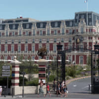 People pass by the Hotel du Palais where Group of Seven delegates will be hosted in Biarritz, southwestern France, ahead of the annual G7 summit from Saturday through Monday. | AFP-JIJI