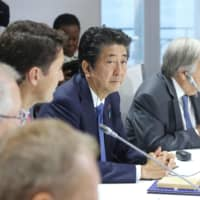 Prime Minister Shinzo Abe attends a Group of Seven summit session in Biarritz, France, on Monday. | POOL / VIA KYODO