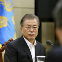South Korean President Moon Jae-in attends a meeting at the Blue House in Seoul on Thursday over the scrapping of a military information-sharing pact with Japan.   SOUTH KOREAN PRESIDENTIAL OFFICE / VIA KYODO