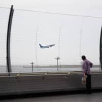 An airplane takes off at Haneda airport in Tokyo in May. | BLOOMBERG
