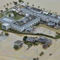 Floodwater isolates Juntendo hospital in Omachi, Saga Prefecture, on Thursday following torrential rain that hit areas of southwestern Japan. | KYODO