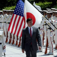 U.S. Secretary of Defense Mark Esper inspects an honor guard Aug. 7 before meeting with defense chief Takeshi Iwaya in Tokyo. | REUTERS