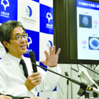 Koji Nishida, who heads the Osaka University team that conducted the world's first iPS transplant of corneal tissues, speaks at a news conference Thursday at the university. | KYODO