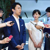 Liberal Democratic Party lawmaker Shinjiro Koizumi and TV journalist Christel Takigawa discuss their marriage plans Wednesday at the Prime Minister's Office in Tokyo. | KYODO