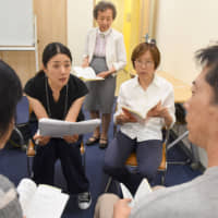 Miho Ohashi takes a lesson at the International Medical Interpreter Academy in Tokyo on July 23. | SATOKO KAWASAKI