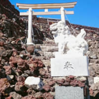 Stones near the summit of Mount Fuji are seen blocking a route to the summit after a typhoon last autumn. | YAMANASHI PREFECTURAL GOVERNMENT / VIA KYODO