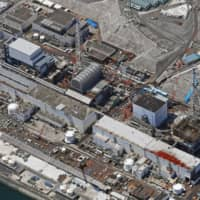 Decommissioning work continues at the Fukushima No. 1 nuclear power plant in April. The government has reportedly told the United States it is ready to provide robot technology for dismantling the nuclear and uranium enrichment facilities in North Korea. | KYODO