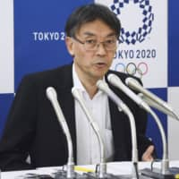 An Tokyo Organising Committee official announces on July 4 in Tokyo that an additional lottery will be held for those who didn't win any tickets during the first-round lottery in June. | KYODO