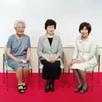 Former members of the translation team that volunteered during the 1964 Tokyo Paralympics (from left) Akiko Wakai, Mutsuko Inada and Akiko Gono speak about their experiences during the opening of an exhibit at the Japanese Red Cross Society in August. | RYUSEI TAKAHASHI