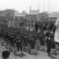 Japanese athletes march in the Tokyo Paralympics opening ceremony in 1964.  | KYODO