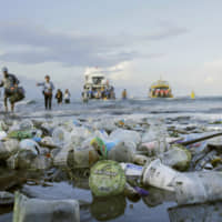 Plastic waste is seen on an Indonesian coast in April last year. | REUTERS / VIA KYODO