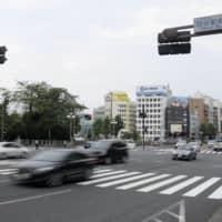 A crosswalk in front of JR Yotsuya Station in Tokyo is seen Sunday after an incident earlier the same day in which a police car hit and seriously injured a 4-year-old boy. | KYODO