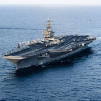 The Nimitz-class aircraft carrier USS Abraham Lincoln is shown in the Arabian Sea in January 2012.   UPI / VIA KYODO