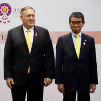 Foreign Minister Taro Kono, U.S. Secretary of State Mike Pompeo and South Korean Foreign Minister Kang Kyung-wha pose after a trilateral meeting in Bangkok on Friday. | REUTERS