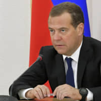 Russian PM Dmitry Medvedev visits disputed island off Hokkaido despite protest from Tokyo