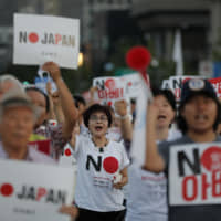 Protesters shout slogans denouncing Prime Minister Shinzo Abe during a rally in Seoul on Saturday. Tokyo on Sunday protested South Korean military exercises that Seoul said were intended 'to defend' a cluster of rocky islands known as Takeshima in Japan and Dokdo in South Korea. | AP