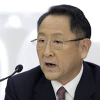 Toyota Motor Corp. President Akio Toyoda holds a news conference in Tokyo in May. | BLOOMBERG