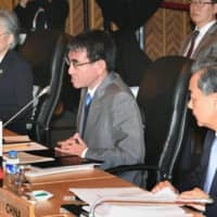 Foreign Minister Taro Kono (center) speaks while seated next to South Korean Foreign Minister Kang Kyung-wha (left) and Chinese Foreign Minister Wang Yi at a meeting in Manila in August 2017.   KYODO