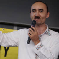 Afumetto Retepu, who lost contact with 12 members of his family, calls for support in finding the truth about the  fate of the Uyghurs in China's Xinjiang province, during a symposium in Tokyo on July 6. | MAGDALENA OSUMI
