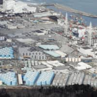 A massive number of tanks storing treated water at the Fukushima No. 1 plant are seen in February.   KYODO
