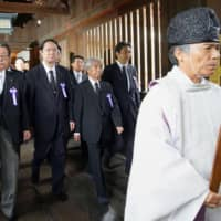 A group of lawmakers visit Yasukuni Shrine in Tokyo on Thursday. | KYODO