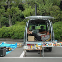 Getting the boot: A vendor relaxes in the back of his car at the Oi Racecourse Flea Market. | REBECCA SAUNDERS