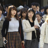 Japan's female labor participation rate — previously among the lowest in the OECD — has soared to a record 71 percent, but Japan ranked just 110 out of 149 countries in the World Economic Forum's latest Global Gender Gap Index . | AP