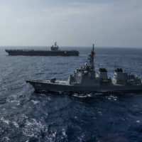 The Maritime Self-Defense Force guided-missile destroyer Myoko sails with the USS Ronald Reagan aircraft carrier in the Philippines Sea on Aug. 15. The Japan-U.S. alliance plays a key role in Japan's 'Free and Open Indo-Pacific Strategy.'   USS RONALD REAGAN (CVN 76)