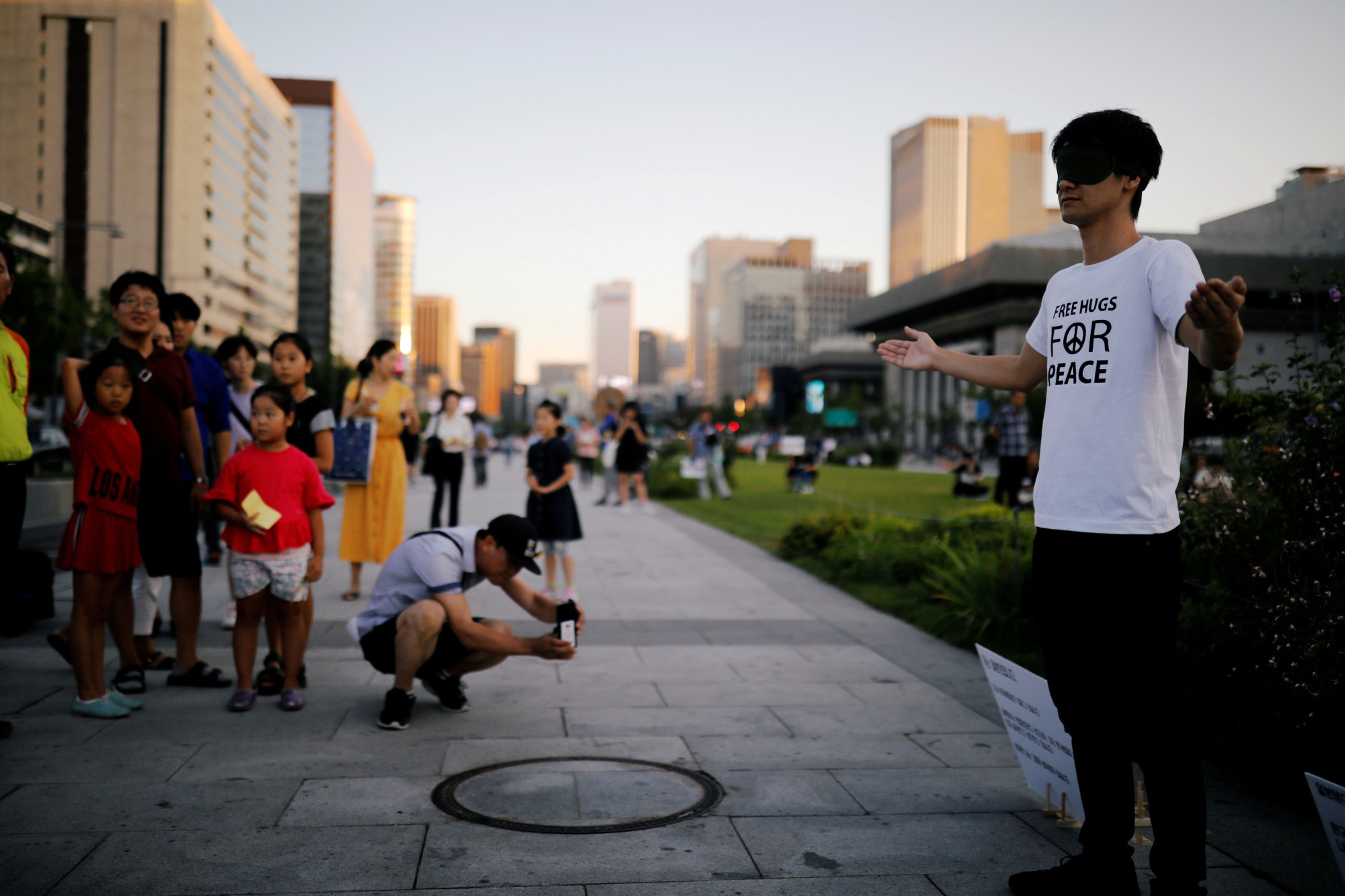 A Japanese man offers free hugs to South Koreans attending an anti-Japan rally in Seoul on Saturday. | REUTERS
