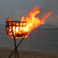 Light my way: The okuribi fire is presided over by a priest who chants as island spirits are sent back out to sea together with those of the dead warriors for tōrō nagashi (floating lantern) festival. | AMY CHAVEZ