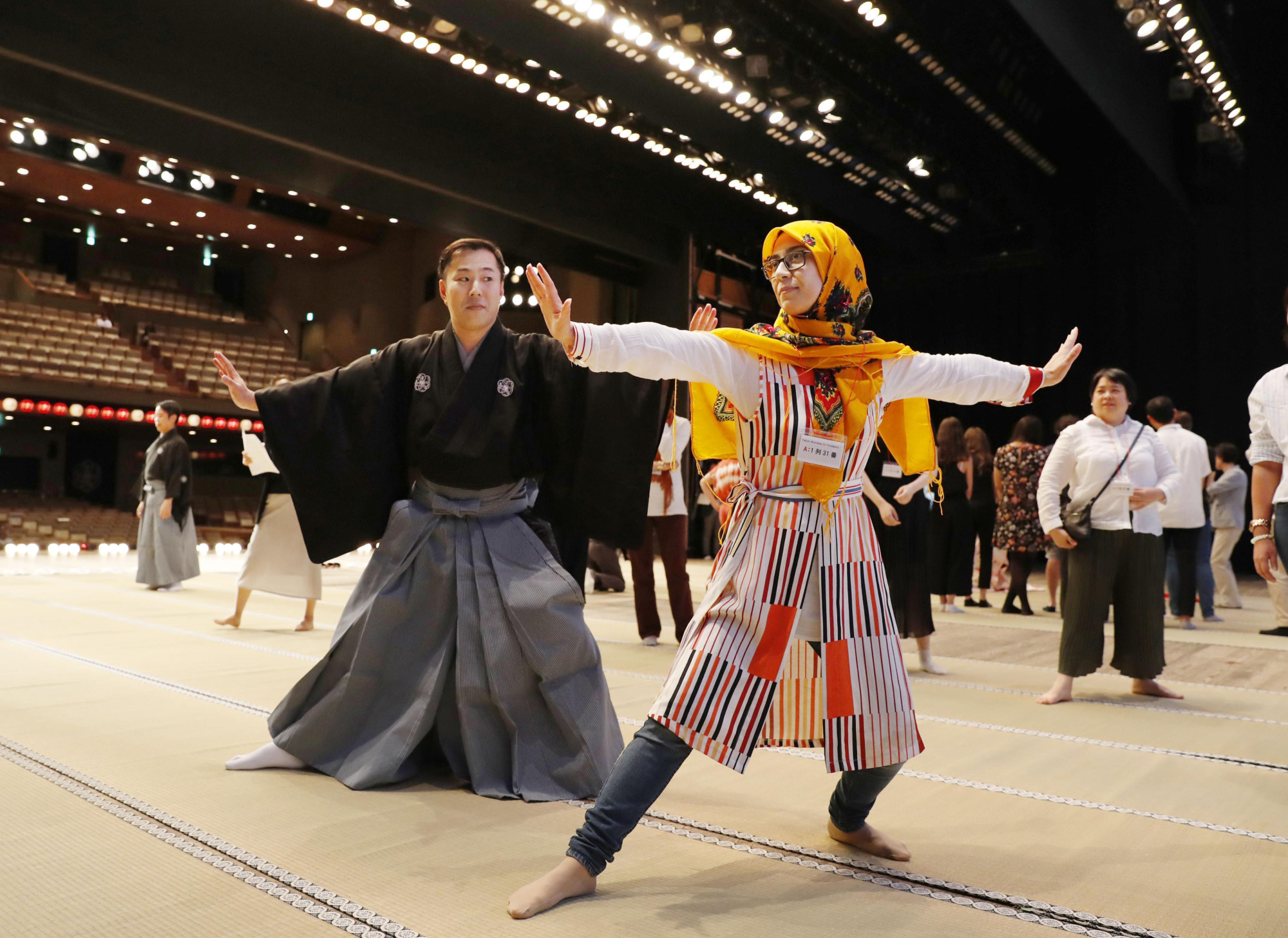 Strike a pose: An Iranian student attends a kabuki workshop for foreign participants at the National Theatre in Tokyo. | KYODO