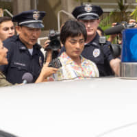 Long arm of the law: Toru Muranishi found himself locked up in Hawaii after falling foul of sex-trafficking laws.