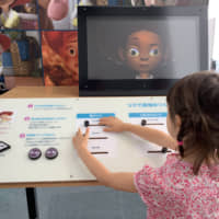 Funny faces: Learning how Pixar characters' features are manipulated is just one of many activities at 'The Science Behind Pixar,' now on show at Roppongi Hills Observation Deck Tokyo City View. | DANIELLE DEMETRIOU