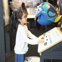 Pushing the right buttons: 'The Science Behind Pixar' exhibition features interactive exhibits, all designed to teach visitors about the complex process of animation. | © DISNEY / PIXAR