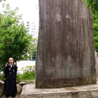 Priest Tamura with a Russo-Japanese War (1904-05) monument. | KIT NAGAMURA