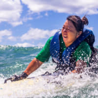 Surfs up: Since moving to Hawaii in 2015, Atsuko Kuwana has had time to focus on her love of surfing and scuba diving. | ACCESSURF
