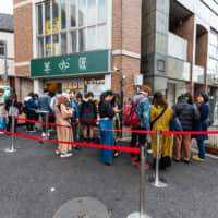 Bubble economy: Customers stand in line outside a tapioca tea shop near Tokyo's Takadanobaba district. | GETTY IMAGES