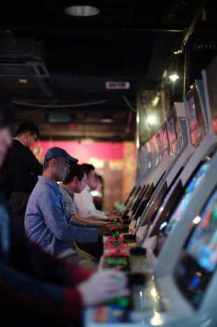 Arcade fire: Contestants play games in a tournament at the Mikado amusement arcade in Tokyo's Takadanobaba district earlier this year. | RYUSEI TAKAHASHI