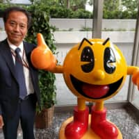 Hitoshi Hagiwara, president and chief executive officer of Bandai Namco Amusement Inc., believes the image of arcades as simply places to sit down and play video games has been outdated for some time. | ANDREW MCKIRDY