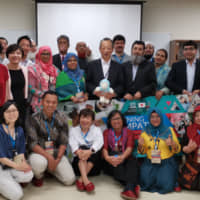 Teachers and officials from Bangladesh, Indonesia and Pakistan together with UNESCO staff and Japanese teachers pose for a group photograph at a workshop held at Funabashi Kibou Junior High School in Tokyo's Setagaya Ward last month. | UNESCO / SANTIBHAP USSAVASODHI.
