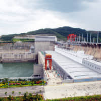 The Jinghong Dam is just one of a number of dams that China has built on the upper Mekong River. China has more dams in operation than the rest of the world combined. | DYCJ — IMAGINECHINA