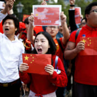 Supporters of the Chinese government hold a demonstration in London on Aug. 17 against the protests in Hong Kong. | REUTERS