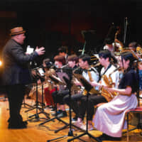 Trombonist and Seiko Summer Jazz Camp lead instructor Michael Dease conducts a big band performance with all the students during last year's gala concert at Shobi Vario Hall in Tokyo on Aug. 17, 2018. | SEIKO SUMMER JAZZ CAMP